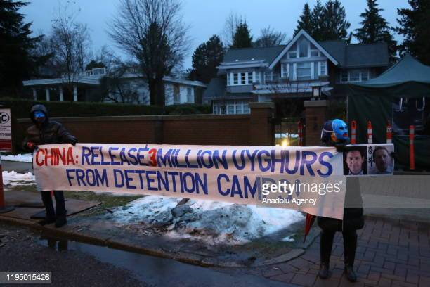 Uyghur activists protest China's treatment of Uyghurs outside the house of Huawei Technologies Chief Financial Officer Meng Wanzhou on the first day...