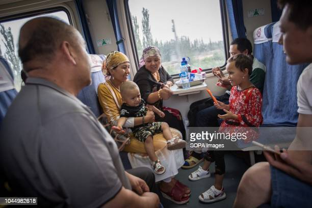 Uyghur and Han Chinese seen spending time inside a train from Hotan to Kashgar in Xinjiang Uyghur Autonomous Region in China Kashgar is located in...