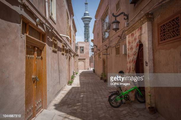 Uyghur boy enter a house with his bicycle in the Kashgar old town northwestern Xinjiang Uyghur Autonomous Region in China Kashgar is located in the...