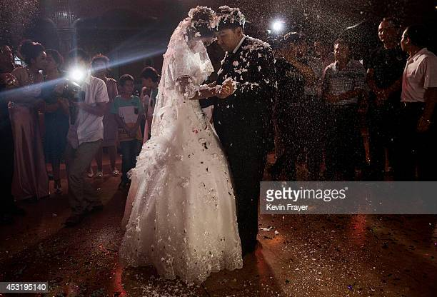 Uyghur couple have their first dance at their wedding celebration after being married on August 2 2014 in Kashgar Xinjiang Uyghur Autonomous Region...