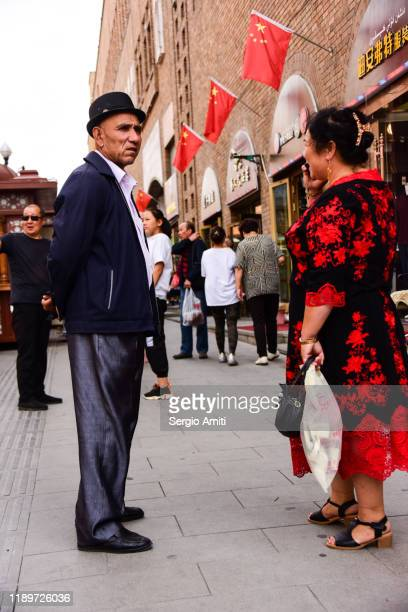 uyghur couple in urumqi, xinjiang - sergio amiti stock pictures, royalty-free photos & images