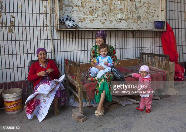 Uyghur family in the street Kashgar Xinjiang Uyghur Autonomous Region China on September 25 2012 in Kashgar China