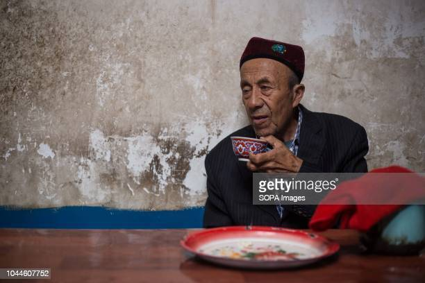 Uyghur man drink tea while chasing with friends at a local tea shop in the Kashgar old Town in Kashgar city northwestern Xinjiang Uyghur Autonomous...