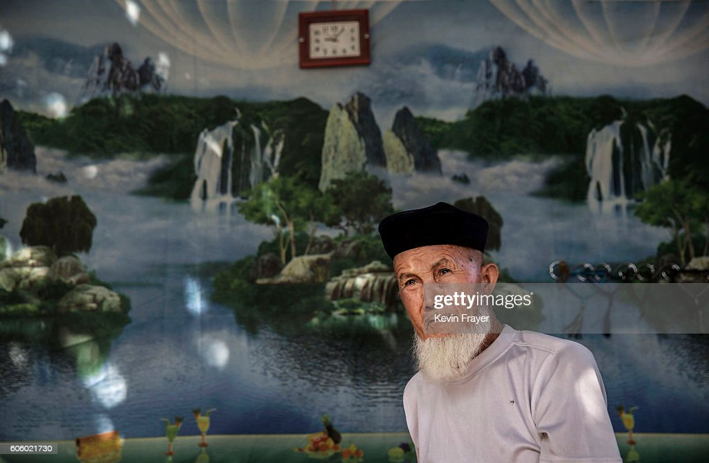 A Uyghur man sits in his house as he waits for relatives to visit during the Corban Festival on September 12, 2016 in Turpan County, in the far western Xinjiang province, China. The Corban festival, known to Muslims worldwide as Eid al-Adha or 'feast of the sacrifice', is celebrated by ethnic Uyghurs across Xinjiang, the far-western region of China bordering Central Asia that is home to roughly half of the country's 23 million Muslims. The festival, considered the most important of the year, involves religious rites and visits to the graves of relatives, as well as sharing meals with family. Although Islam is a 'recognized' religion in the constitution of officially atheist China, ethnic Uyghurs are subjected to restrictions on religious and cultural practices that are imposed by China's Communist Party. Ethnic tensions have fueled violence that Chinese authorities point to as justification for the restrictions.