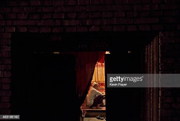 Uyghur man sits in his house on August 1 2014 in old Kashgar Xinjiang Uyghur Autonomous Region China Nearly 100 people have been killed in unrest in...