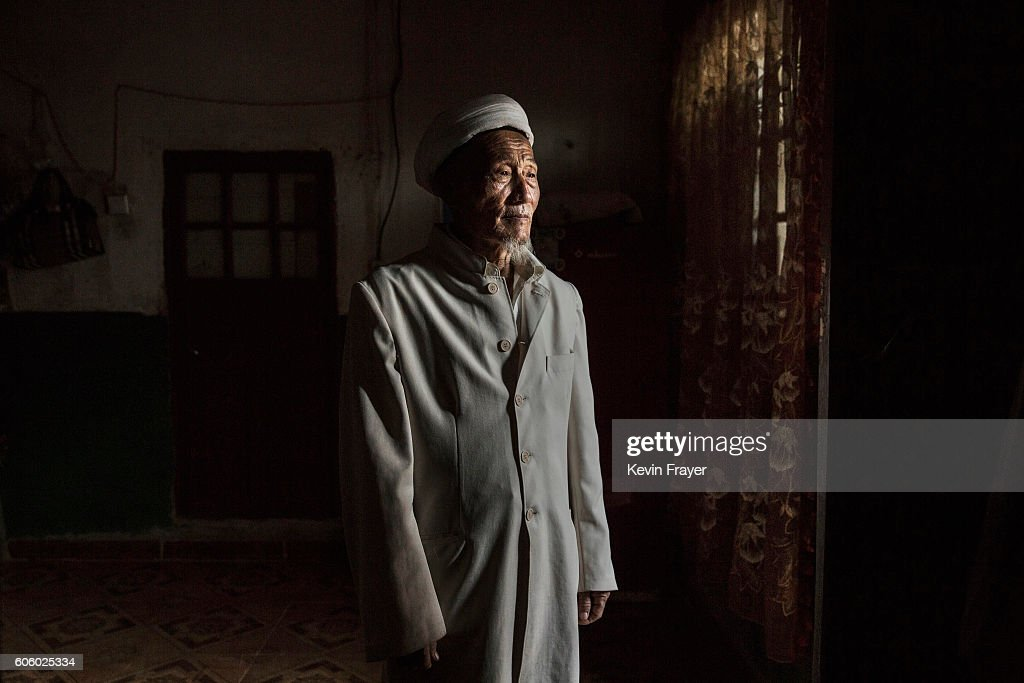 A Uyghur man stands in the doorway of his house after visitors left after a holiday meal during the Corban Festival on September 13, 2016 in Turpan County, in the far western Xinjiang province, China. The Corban festival, known to Muslims worldwide as Eid al-Adha or 'feast of the sacrifice', is celebrated by ethnic Uyghurs across Xinjiang, the far-western region of China bordering Central Asia that is home to roughly half of the country's 23 million Muslims. The festival, considered the most important of the year, involves religious rites and visits to the graves of relatives, as well as sharing meals with family. Although Islam is a 'recognized' religion in the constitution of officially atheist China, ethnic Uyghurs are subjected to restrictions on religious and cultural practices that are imposed by China's Communist Party. Ethnic tensions have fueled violence that Chinese authorities point to as justification for the restrictions.