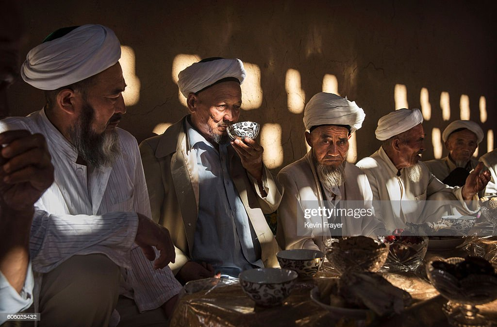 Uyghur men gather for a holiday meal during the Corban Festival on September 13, 2016 in Turpan County, in the far western Xinjiang province, China. The Corban festival, known to Muslims worldwide as Eid al-Adha or 'feast of the sacrifice', is celebrated by ethnic Uyghurs across Xinjiang, the far-western region of China bordering Central Asia that is home to roughly half of the country's 23 million Muslims. The festival, considered the most important of the year, involves religious rites and visits to the graves of relatives, as well as sharing meals with family. Although Islam is a 'recognized' religion in the constitution of officially atheist China, ethnic Uyghurs are subjected to restrictions on religious and cultural practices that are imposed by China's Communist Party. Ethnic tensions have fueled violence that Chinese authorities point to as justification for the restrictions.
