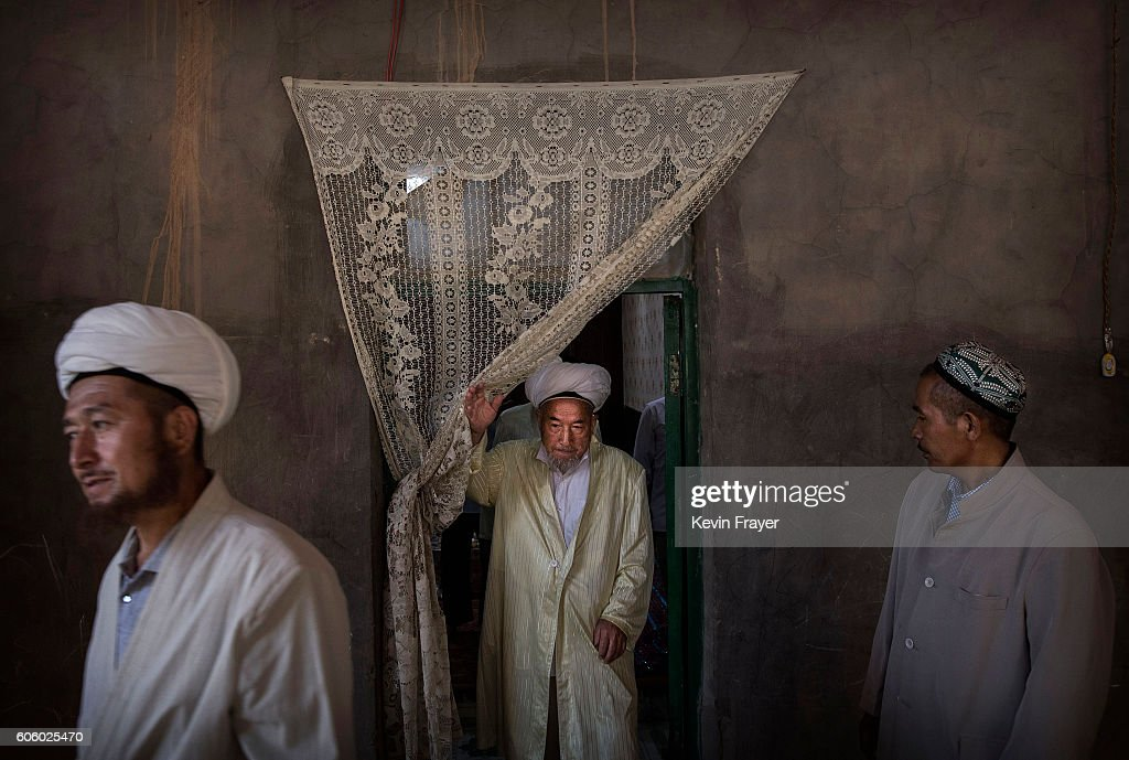 Uyghur men leave after eating a holiday meal during the Corban Festival on September 13, 2016 in Turpan County, in the far western Xinjiang province, China. The Corban festival, known to Muslims worldwide as Eid al-Adha or 'feast of the sacrifice', is celebrated by ethnic Uyghurs across Xinjiang, the far-western region of China bordering Central Asia that is home to roughly half of the country's 23 million Muslims. The festival, considered the most important of the year, involves religious rites and visits to the graves of relatives, as well as sharing meals with family. Although Islam is a 'recognized' religion in the constitution of officially atheist China, ethnic Uyghurs are subjected to restrictions on religious and cultural practices that are imposed by China's Communist Party. Ethnic tensions have fueled violence that Chinese authorities point to as justification for the restrictions.
