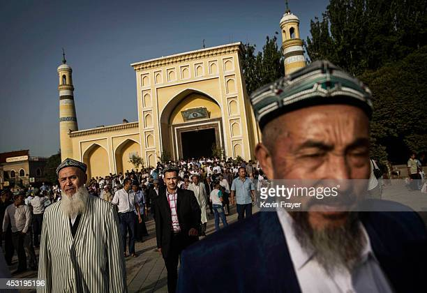 Uyghur men leave the Id Kah Mosque following the Eid prayers on July 29 2014 in old Kashgar Xinjiang Uyghur Autonomous Region China Nearly 100 people...