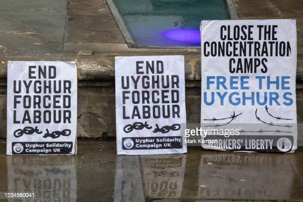 Uyghur Solidarity Campaign UK placards are pictured at a protest opposite the Chinese embassy in support of the Uyghur peoples struggle for freedom...