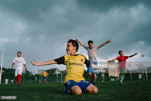 Uyghur students are celebrating a goal June 4 2016 Meizhou of Guangdong Province is the hometown of soccer and R F Soccer School is a school that...