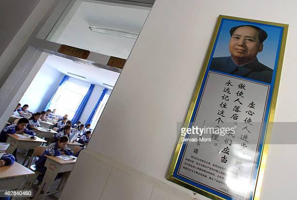 Uyghur students study Mandarin Chinese by a portrait of Mao Zedong in Hetian Experimental Billingual School on October 13 2006 in Hetian Xinjiang...