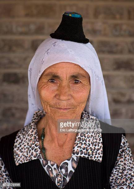 Uyghur woman wearing the smallest hat in the world Keriya Xinjiang Uyghur Autonomous Region China on September 17 2012 in Keriya China