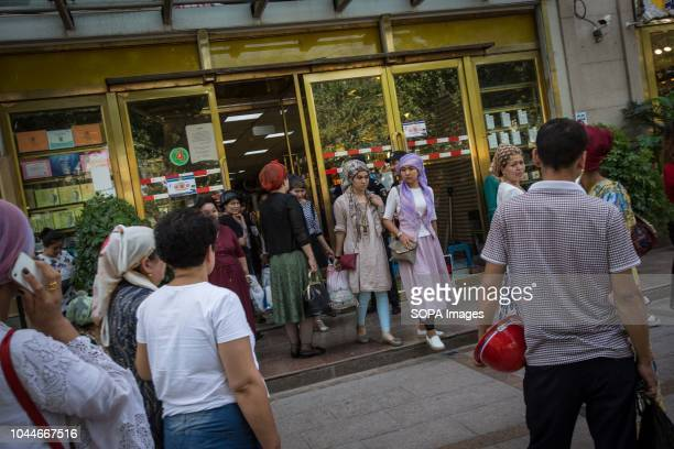 TOWN KASHGAR XINJIANG CHINA Uyghur women walks out a shopping mall center in the Kashgar old town northwestern Xinjiang Uyghur Autonomous Region in...