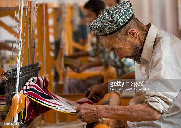 Uyghur worker in a silk factory Hotan Xinjiang Uyghur Autonomous Region China on September 18 2012 in Hotan China
