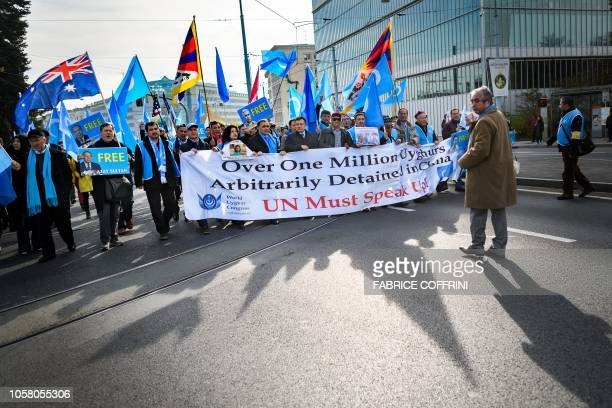 Uyghurs and Tibetan people demonstrate against China outside of the United Nations offices during the Universal Periodic Review of China by the UN...