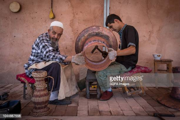 Uyghurs men works outside their local shop while waiting for costumers in the Kashgar old town, northwestern Xinjiang Uyghur Autonomous Region in...