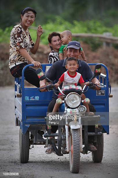 Uygur family go back home on August 18 2010 in Turpan of Xinjiang Autonomous Region China Turpan basin is the second lowest continental point in the...