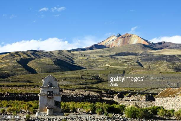 banks of the salt flat Salar de Uyuni Chapel of Tahua at the bottom of the Tunupa Volcano