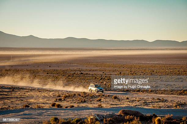 uyuni dirt road - rally car racing stock pictures, royalty-free photos & images