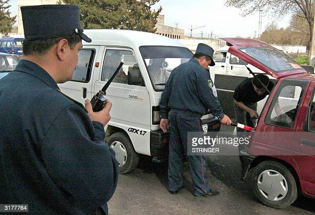 Uzbek police officers search a car on a road in Tashkent 31 March 2004 Uzbekistan clamped down on security Wednesday after two days of blasts and...