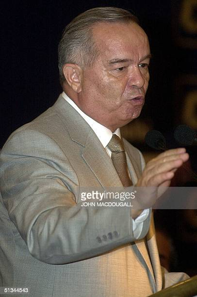 Uzbek President Islam Karimov gestures during his speech to Indian businessmen during a Confederation of Indian Industry function in New Delhi 03 May...