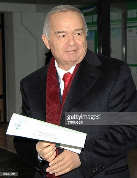 Uzbek President Islam Karimov holds his ballot at a polling station in Tashkent 23 December 2007 Uzbekistan voted Sunday in an election where...