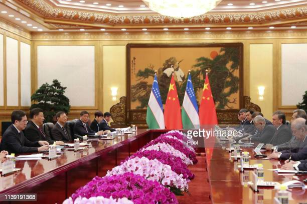 Uzbek president Shavkat Mirziyoyev 3rd right and Chinese President Xi Jinping 2nd left attend the meeting at the Great Hall of People on April 25...