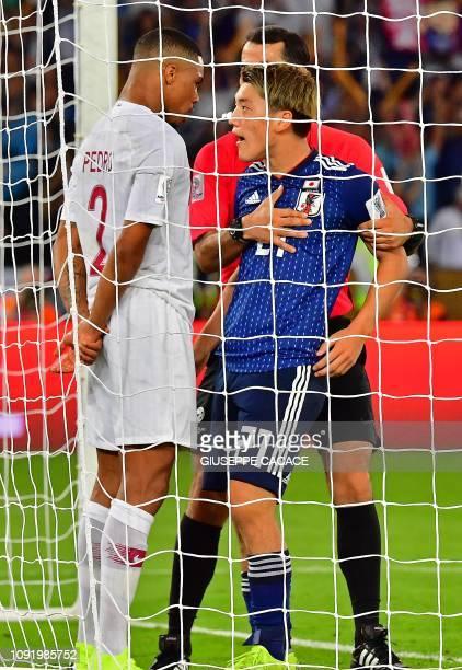 TOPSHOT Uzbek referee Ravshan Irmatov separates Qatar's defender Pedro Miguel Correia and Japan's midfielder Ritsu Doan during the 2019 AFC Asian Cup...