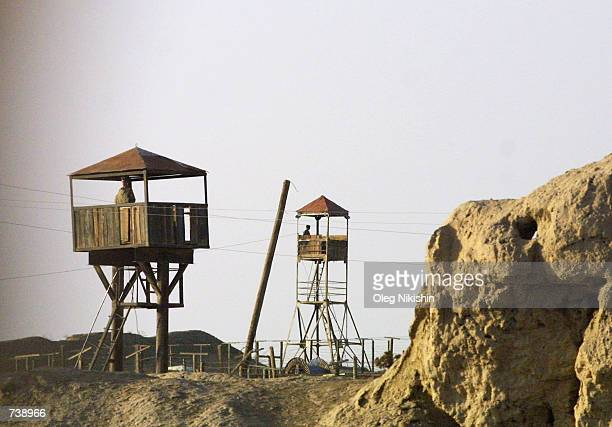 Uzbek soldiers stand guard at watchtowers overlooking the border with Afghanistan November 21 2001 near Termez Uzbekistan Sen Carl Levin chairman of...