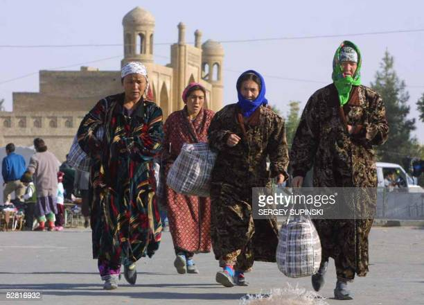 Uzbek women walk on the street in downtown Karshi a small town in Uzbekistan not far from Afganistan's border 10 October 2001 Insurgents stormed key...