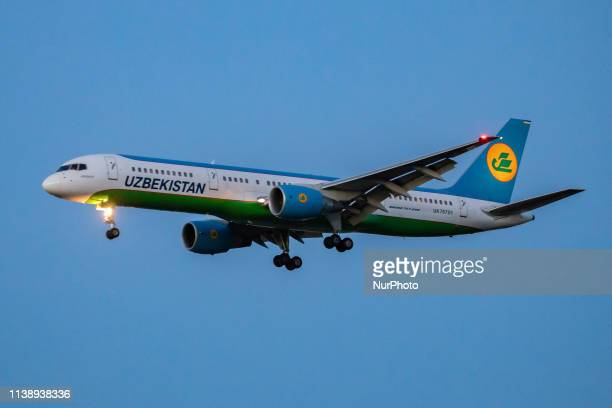 Uzbekistan Airways Boeing 757-200 airplane with registration UK75701 is landing at London Heathrow International Airport in England, UK in the...