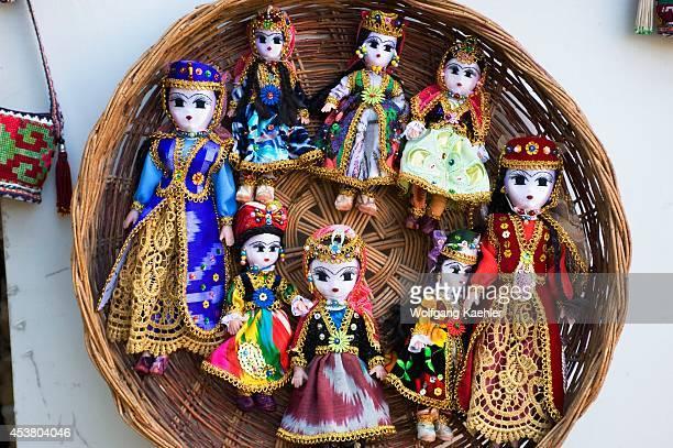 Uzbekistan Bukhara Bazaar Scene With Souvenir Dolls