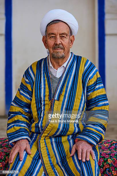 uzbekistan, bukhara, man in chapan - muziek stock pictures, royalty-free photos & images