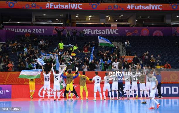Uzbekistan celebrate the victory during the FIFA Futsal World Cup 2021 group B match between Egypt and Uzbekistan at Vilnius Arena on September 18,...