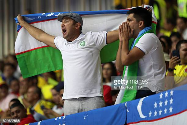 Uzbekistan fans celebrate during the FIFA Futsal World Cup Group A match between Colombia and Uzbekistan at the Coliseo el Pueblo on September 13...
