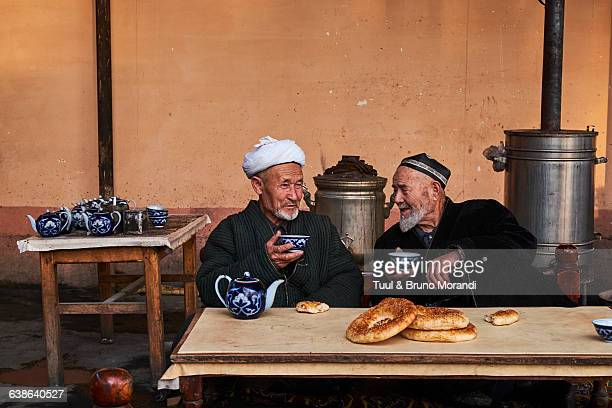 uzbekistan, fergana, traditional tea house - muziek stock pictures, royalty-free photos & images
