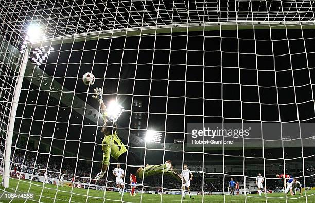 Uzbekistan goalkeeper Ignatiy Nesterov is beaten by a shot from Ji Dong Won of Korea Republic during the AFC Asian Cup 3rd place playoff match...