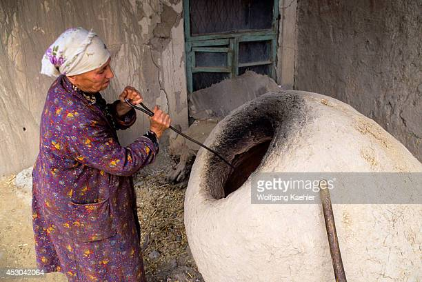 Uzbekistan Khiva Old Town Bread Baking Woman Firing Up Oven
