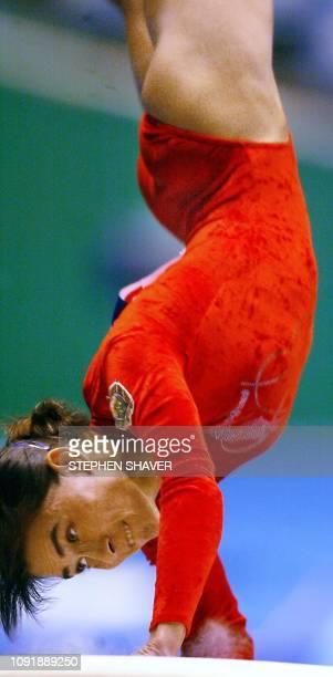Uzbekistan Oksana Chusovitina performs on the vault during the women's apparatus finals for the 14th Asian Games in Busan 04 October 2002 Chusovitina...