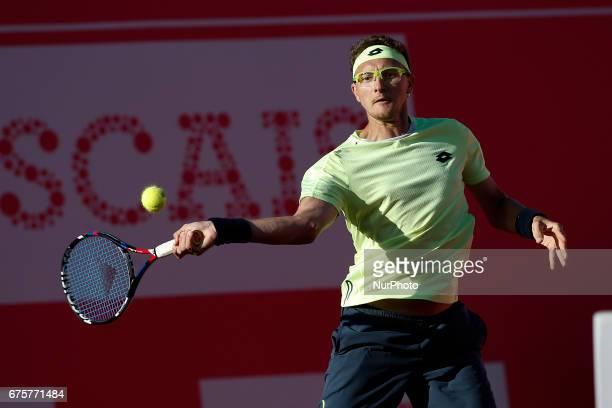 Uzbekistan player Denis Istomin returns the ball to Portuguese tennis player Frederico Ferreira Silva during their Millennium Estoril Open ATP...