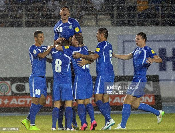 Uzbekistan players celebrate scoring a goal against the Philippines during their 2018 World Cup qualifying football match at the Philippine sports...