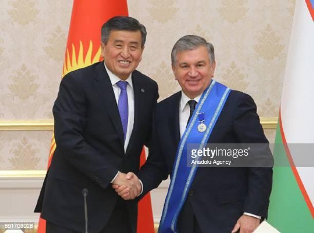 Uzbekistani President Shavkat Mirziyoyev shakes hands with Kirghizstani President Sooronbay Jeenbekov after Mirziyoyev received the Order of Danaker...