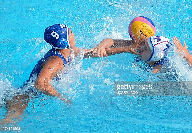 Uzbekistan's Aleksandra Sarancha fights for the ball by Russia's Ekaterina Tankeeva during the preliminary rounds of the women's water polo...