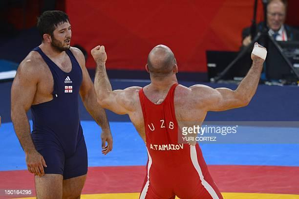 Uzbekistan's Artur Taymazov celebrates after defeating Georgia's Davit Modzmanashvili in their Men's 120kg gold medal match on August 11 2012 during...