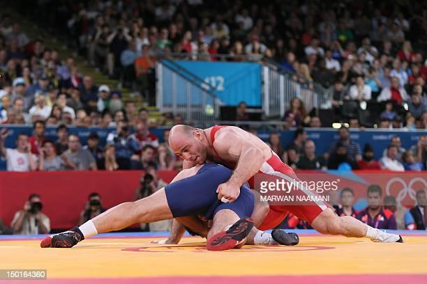 Uzbekistan's Artur Taymazov wrestles Georgia's Davit Modzmanashvili in their Men's 120kg gold medal match on August 11 2012 during the wrestling...