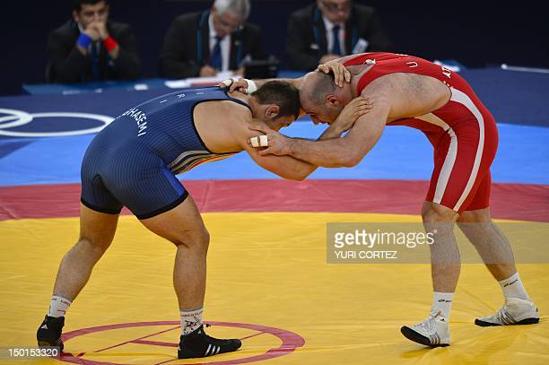 Uzbekistan's Artur Taymazov wrestles Iran's Komeil Ghasemi in their Men's 120kg Freestyle quarterfinal match on August 11 2012 during the wrestling...