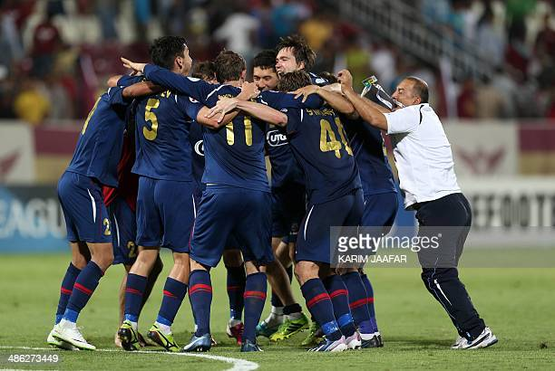 Uzbekistan's Bunyodkor players celebrate after defeating Qatar's ElJaish 21 during their AFC Champions League football match in Doha on April 23 2014...
