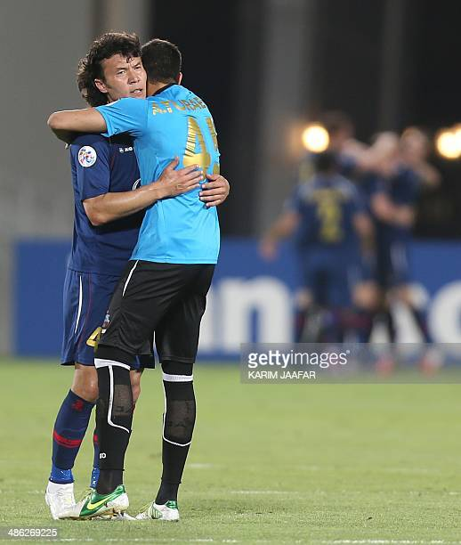 Uzbekistan's Bunyodkor players celebrate after scoring a goal against Qatar's ElJaish during their AFC Champions League football match in Doha on...
