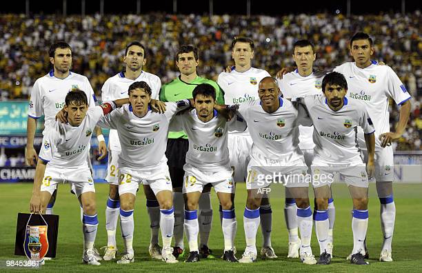 Uzbekistan's Bunyodkor players pose for a picture before their AFC Champions League group B football match against AlIttihad in Jeddah on April 14...